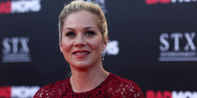 "Cast member Christina Applegate poses at the premiere of ""Bad Moms"" in Los Angeles, California U.S., July 26, 2016.   REUTERS/Mario Anzuoni - RTSJTQR"