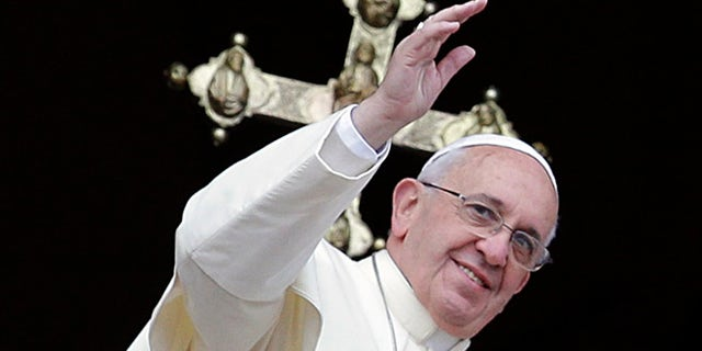 """Dec. 25, 2013: Pope Francis delivers his """"Urbi et Orbi"""" (to the City and to the World) message from the central balcony of St. Peter's Basilica at the Vatican."""