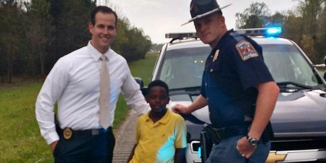 Ala. AG Investigator Eric Salvador, Christopher Wheeler, the young hero,  and Trooper Lee Walls. (ALEA)
