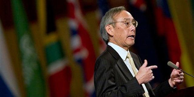 Secretary of Energy Steven Chu gestures as he delivering a keynotes address at a conference in Beijing, China, Sept. 22.
