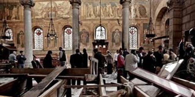 Security forces examine the scene inside the St. Mark Cathedral in central Cairo in December 2016, following a bombing that killed dozens of people.