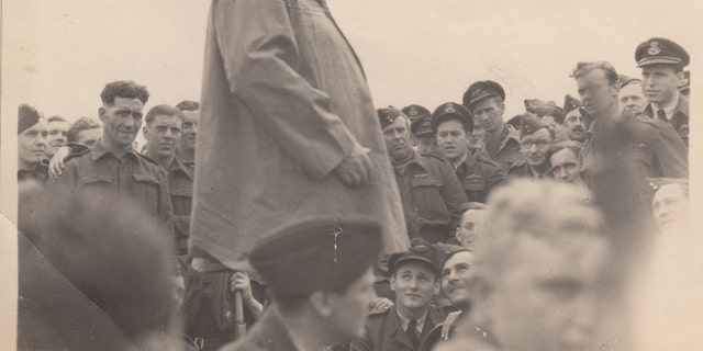 Churchill can be seen with RAF personnel at Airfield B3 near Gold Beach in Normandy (Henry Aldridge & Son)