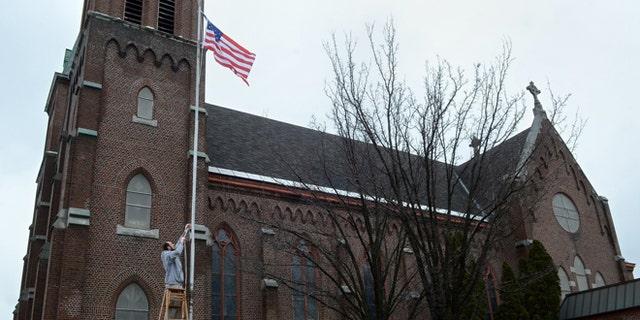 March 30, 2014: This photo shows the former Holy Trinity Roman Catholic Church in Syracuse, N.Y. The church will soon be called Masjid Eisa Ibn Marya - The Mosque of Jesus son of Mary.