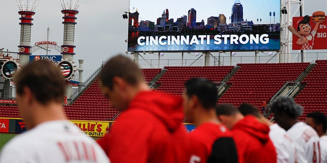 A moment of silence is observed in Cincinnati for the three dead and others wounded in a shooting downtown, at the Great American Ball Park before a baseball game between the Cincinnati Reds and the San Diego Padres.