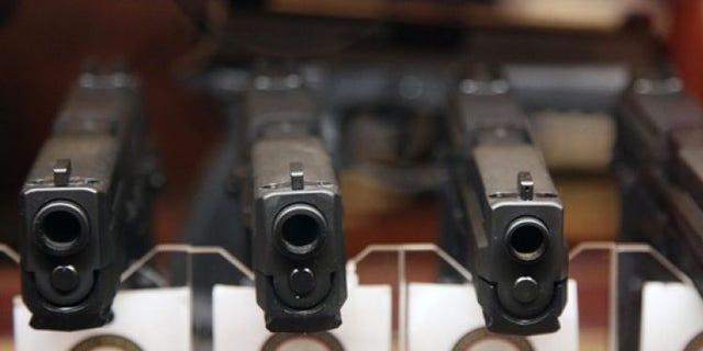 Jan. 4, 2013: Handguns are displayed in the sales area of Sandy Springs Gun Club and Range, in Sandy Springs, Ga.