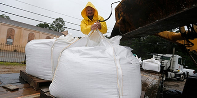 Volunteers put out sand bags due to the arrival of Tropical Storm Cindy in Lafitte, La., June 21.