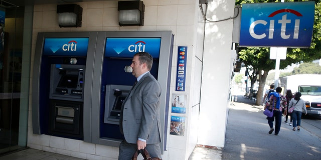 File photo - A man walks past a Citibank ATM in Los Angeles, California, March 10, 2015. (REUTERS/Lucy Nicholson)