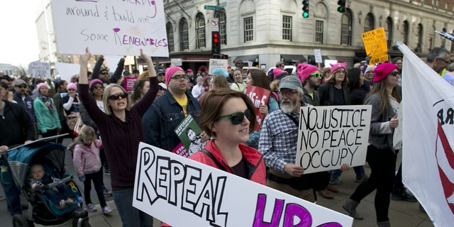 """Protesters march up Fayetteville Street during the annual """"Historic Thousands on Jones Street"""" (HKonJ) march in Raleigh, N.C., on Saturday, Feb. 11, 2017."""