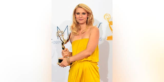 "Actress Claire Danes wins Best Actress Emmy for ""Homeland"" at the 64th Primetime Emmy Awards in Los Angeles September 23, 2012."
