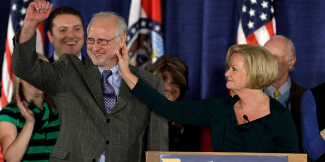 In this Nov. 6, 2012 file photo, Sen. Claire McCaskill, D-Mo., touches the face of her husband, Joseph Shepard, while declaring victory in the Missouri Senate race in St. Louis.