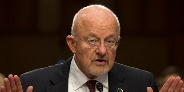 FILE: Sept. 26, 2013: Director of National Intelligence James Clapper testifies on Capitol Hill in Washington.