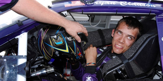 FILE - In this Oct. 4, 2007, file photo, Bryan Clauson smiles in his car during qualifying for the ARCA RE/MAX Series 250 auto race, at Talladega Superspeedway in Talladega, Ala.  (AP Photo/Rainier Ehrhardt, File)