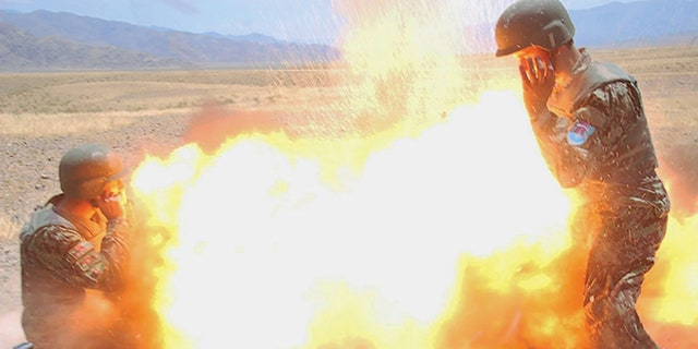 Photo taken by an Afghan Army photographer of the moment when a mortar tube accidentally exploded during an Afghan National Army (ANA) live-fire training exercise in Laghman Province, Afghanistan.