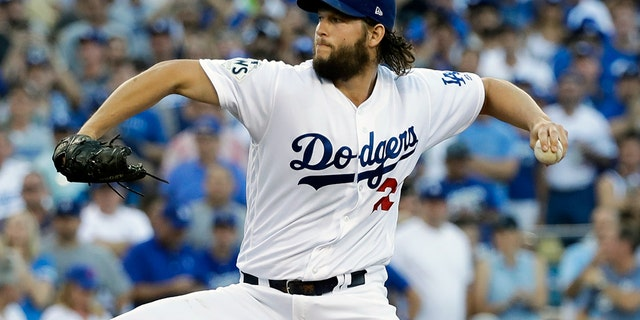 Clayton Kershaw delivered the first pitch of the 113th World Series