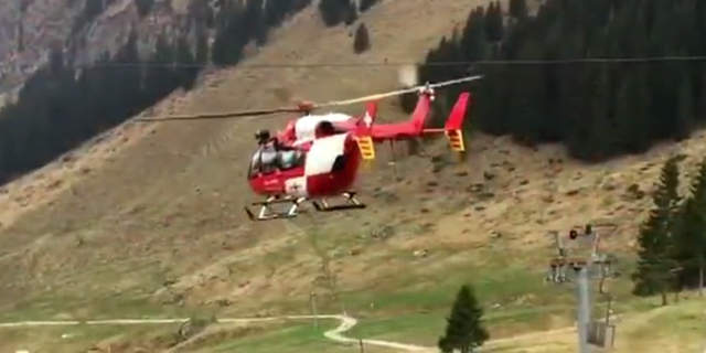 A rescue helicopter at the mountain in Lucerne.