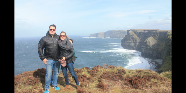 Caryn and her husband Matt O'Hara hiking the Cliffs of Moher in Ireland, March 2016