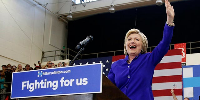 Hillary Clinton takes the stage at a rally, Monday, June 6, 2016, in Long Beach, Calif.