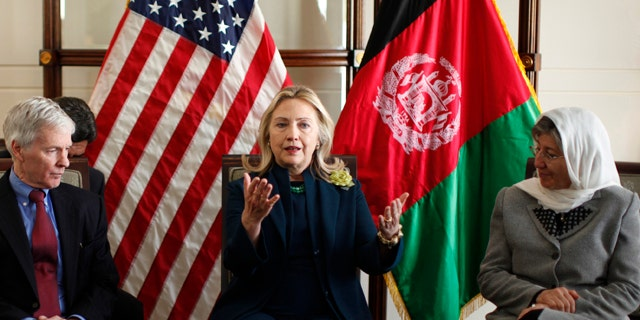 Oct. 20, 2011: U.S. Secretary of State Hillary Rodham Clinton, center, hosts a Civil Society roundtable discussion at the U.S. Embassy in Kabul, Afghanistan. Flanking Clinton are U.S. Ambassador Ryan Crocker, left, and Dr. Sima Samar.