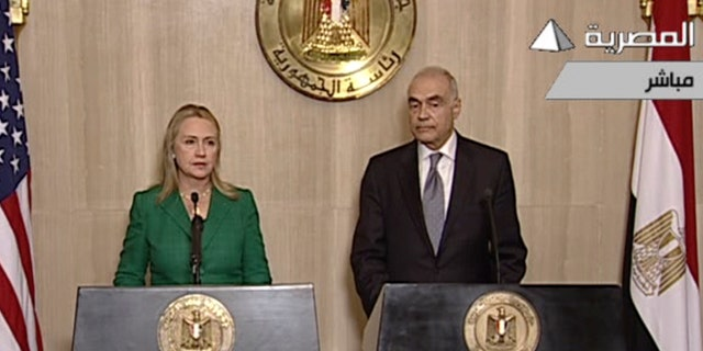 Nov. 21, 2012: In this image made from Egyptian State Television, U.S. Secretary of State Hillary Rodham Clinton, left, and Egyptian Foreign Minister Mohammed Kamel Amr, right, give a joint news conference announcing a cease-fire between Israel and Hamas in Cairo, Egypt.