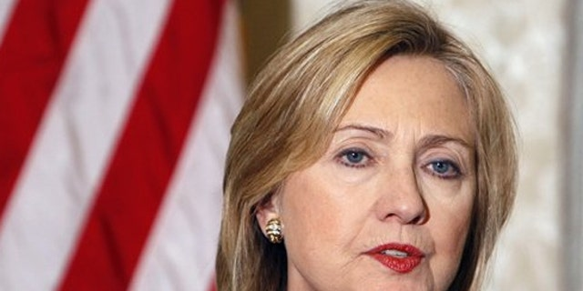 Secretary of State Hillary Clinton addresses reporters during a press conference at the U.S. embassy in Paris March 19.