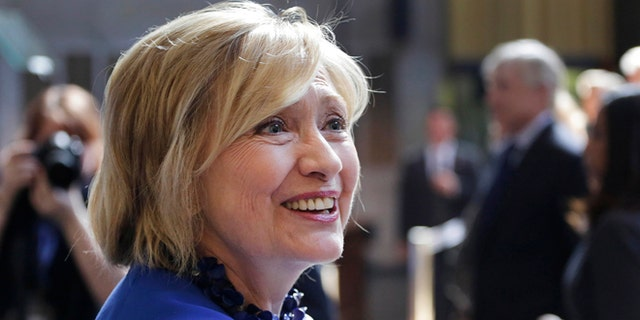 April 29, 2015,: Hillary Rodham Clinton, a 2016 Democratic presidential contender, greets members of the audience following her speech at the David N. Dinkins Leadership and Public Policy Forum in New York.