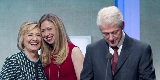 The Clintons don't draw salaries from their family foundation, but critics say they benefit in other ways. (AP)