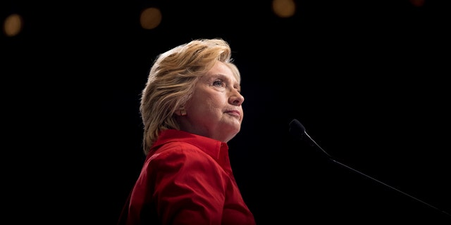 FILE - In this Saturday, July 30, 2016 file photo, Democratic presidential candidate Hillary Clinton pauses while speaking at a rally in Pittsburgh during a bus tour through the rust belt. In 2016, after repeated attempts to break into various staffers' hillaryclinton.com email accounts, the hacking group known as Fancy Bear took a new tack, targeting top Clinton lieutenants at their personal Gmail addresses. (AP Photo/Andrew Harnik)