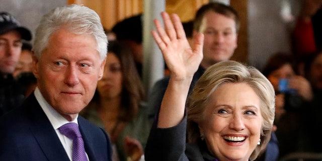 Hillary Clinton departs a Manhattan hotel with her husband, former U.S. President Bill Clinton, on Nov. 9, 2016.