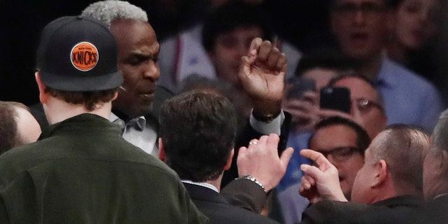 Feb. 8, 2017: Former New York Knicks player Charles Oakley exchanges words with a security guard during the first half of an NBA basketball game between the New York Knicks and the Los Angeles Clippers at Madison Square Garden in New York