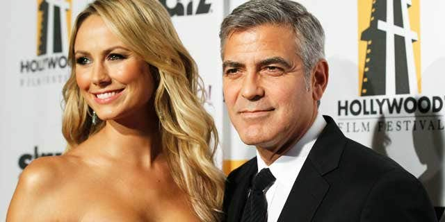 October 25, 2011: George Clooney and Stacy Keibler at the 15th Annual Hollywood Awards Gala in Beverly Hills.