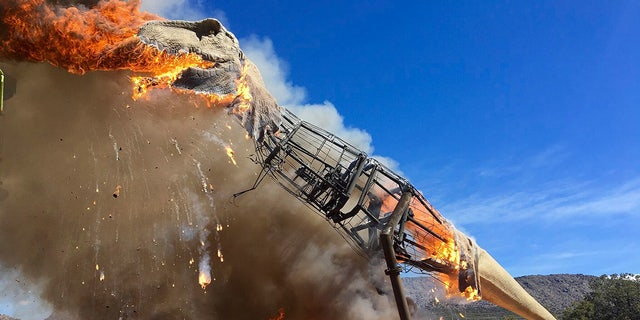 A life-sized animatronic Tyrannosaurus Rex at the Royal Gorge Dinosaur Experience in Canon City, Colo., is ablaze after an electrical issue, according to Royal Gorge Dinosaur Experience personnel.