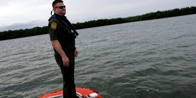 MARATHON, FL - JANUARY 30:  U.S. Border Patrol agent Dan Schaefer rides on a Coast Guard boat as they look for possible boats smuggling humans on January 30, 2007 in Marathon, Florida. Along the Florida Keys the Border Patrol depends on interagency cooperation to help in their primary mission to detect and apprehend illegal aliens and smugglers trying to get into the United States. Some experts suggest that when Cuban President Fidel Castro dies there may be a mass migration to the United States with the Border Patrol on the front line trying to keep an orderly immigration process active. The Border Patrol also looks out for terrorists and terrorists weapons, as well as any other illegal activity.  (Photo by Joe Raedle/Getty Images)