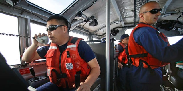 Jan. 28, 2014: Coast Guard officer William Pless communicates on the radio  during a patrol off the San Diego coast. With the drug war targeting land routes across Latin America and the U.S. border, smugglers have been increasingly using large vessels to carry multi-ton loads of cocaine and marijuana hundreds of miles offshore.