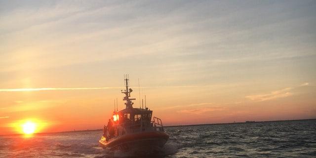 A 45-foot Response Boat-Medium crew from Coast Guard Station Wrightsville Beach approaches a capsized vessel near Masonboro Inlet, North Carolina, June 28, 2017.