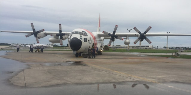 An Air Station Clearwater HC-130 Hercules airplane medevacs four American citizens from Exuma, Bahamas, to Clearwater, Florida, June 30, 2018.