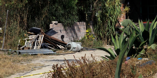 A container reportedly used to transport cobalt-60 (C) is seen at a home near where the dangerous radioactive medical material was found in a truck in the town of Hueypoxtla, near Mexico City December 5, 2013. (REUTERS/Henry Romero)