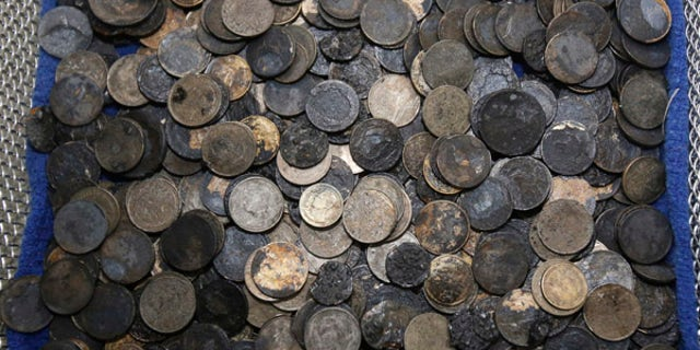 """A picture of coins that were removed from a female green turtle nicknamed """"Bank."""""""