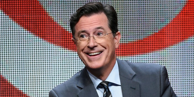 """FILE - In this Aug. 10, 2015 file photo, Stephen Colbert participates in the """"The Late Show with Stephen Colbert"""" segment of the CBS Summer TCA Tour in Beverly Hills, Calif. Colbert gleefully responded on his May 11, 2017, show to insults hurled his way by President Donald Trump, cheering the fact that he finally got Trump to say his name. (Photo by Richard Shotwell/Invision/AP, File)"""