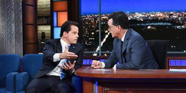 """In this photo provided by CBS, Anthony Scaramucci, left, appears on CBS' """"Late Show"""" with Stephen Colbert, Monday, Aug. 14, 2017, in New York. (Scott Kowalchyk/CBS via AP)"""