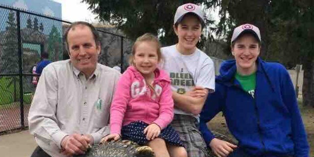 Daniel Briel, left, and his 14-year-old son, David Briel, center, were both killed in a collapse in a silo at their Wisconsin farm.