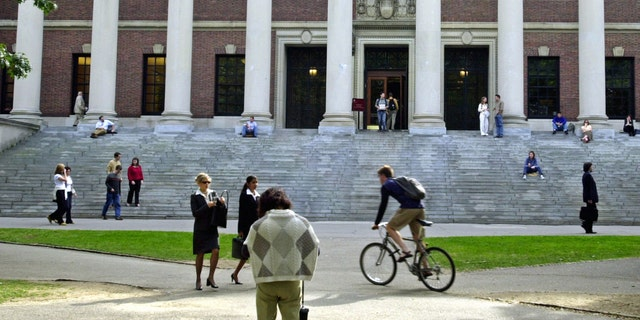 CAMBRIDGE, MA - OCTOBER 10:  Students pass in front of Harvard's Widener Library on October 10, 2003 in Cambridge, Massachusetts.  (Photo by William B. Plowman/Getty Images)