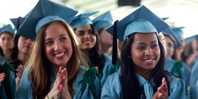 A gender gap is widening among members of Generation X when it comes to getting a college degree. (AP file)