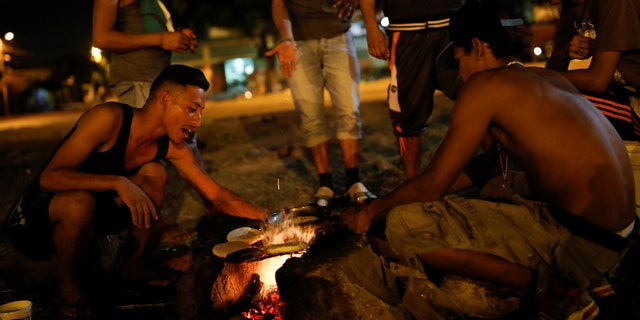 Venezuelan migrants cooking at a rec center in Cúcuta, Colombia, where they have taken shelter.