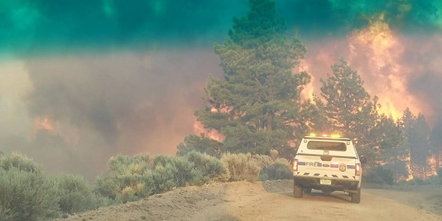 Photo shows an emergency vehicle June 27 during efforts to contain the Spring Creek Fire.