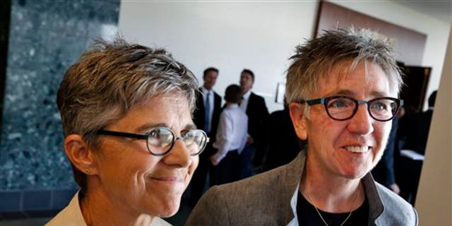 June 16, 2014: Plaintiffs in a gay-marriage case and longtime couple Rebecca Brinkman, left, and Margaret Burd take questions from members of the media following a hearing at Adams County District Court, in Brighton, Colo.