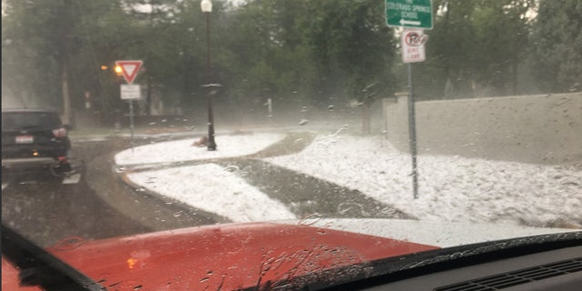 Large hail blanketed the area near the Cheyenne Mountain Zoo on Monday.