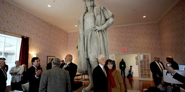 Guests stand in what is known as the living room created by artist Tatzu Nishi that surrounds Gaetano Russo's 1892 sculpture of Christopher Columbus 75 feet above Columbus Circle.