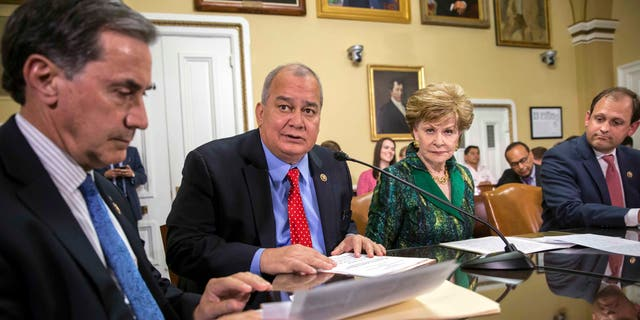 Rep. Gary Palmer, R-Ala., Del. Gregorio Kilili Camacho Sablan, D-Northern Mariana Islands, Del. Madeleine Bordallo, D-Guam, and Rep. Andy Barr, R-Ky., go before the House Rules Committee to prepare a bill for floor debate that would create a financial control board for Puerto Rico and restructure some of the U.S. territory's $70 billion debt, at the Capitol in Washington, Wednesday, June 8, 2016.
