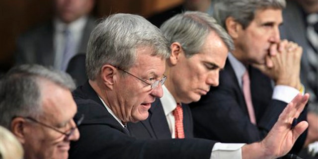 Oct. 26, 2011: Members of the deficit Super Committee meet on Capitol Hill. From left are Sen. Jon Kyl, Sen. Max Baucus, Sen. Rob Portman, and Sen. John Kerry.