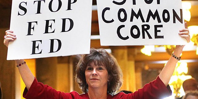 An opponent protests Common Core State Standards in Indianapolis. Indiana was the first state to back out of the national education standard. (AP)